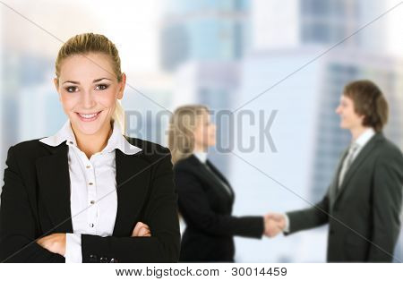 Business woman in an office environment with team