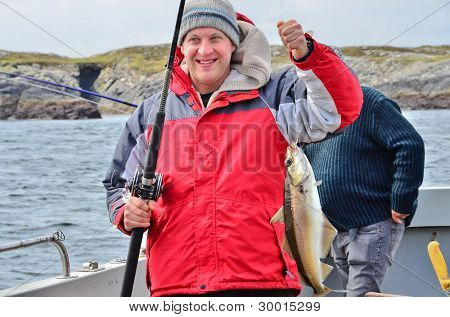 Fisherman with pollock
