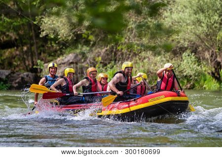 Adventure Team Doing Rafting On The Cold Waters Of The Nestos River