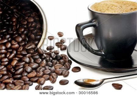 Coffee Beans And Black Cup