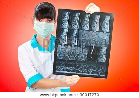 Doctor with xray on a red background