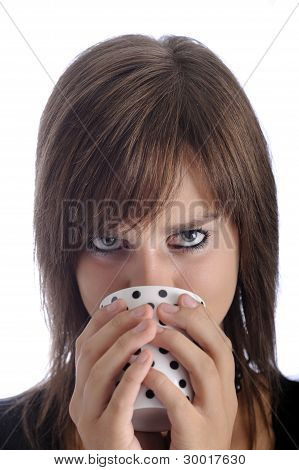 Teenage Girl Looking From Above A Cup