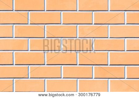 Brick wall background - new bricks wall pattern. Texture brick wall of beige color. Brick wall texture, background of brick wall
