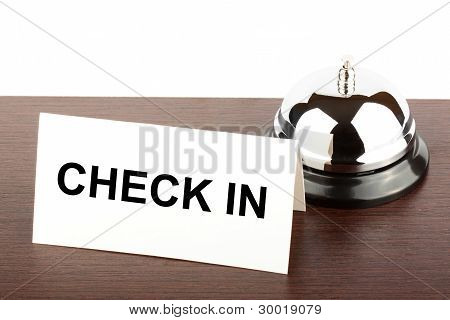 Service Bell with Check in Sign at Hotel Desk poster