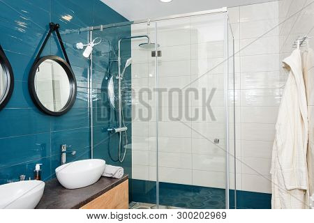 Modern Bathroom Interior With A Wooden Shelf, Two Sinks Standing On It And Round Mirrors. Transparen