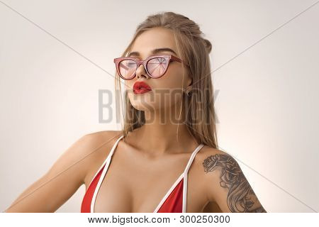 Glamour Beach Woman With Perfect Makeup Wearing Sexy Red Bikini And Retro Sunglasses Isolated On Bri