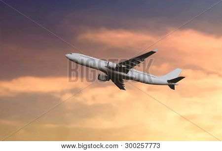 Passenger Airplane Flying During Sunset Under Cloudy Sky