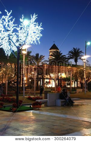 Fuengirola, Spain - December 19, 2008 - Christmas Decorations In A Plaza With The Carmen Church Bell