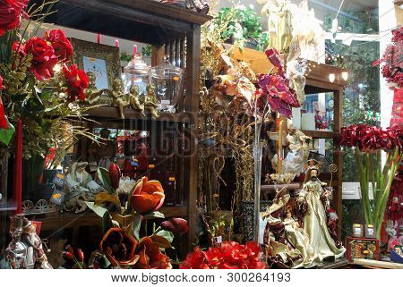 Fuengirola, Spain - December 19, 2008 - Christmas Decorations And Flowers In Shop Window