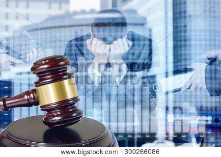 The Concept Of Bankruptcy Of The Business. A Closeup Of An Auction Gavel With A Transparent Figure O