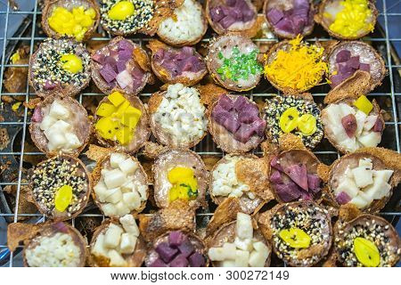 Thai coconut pudding (Kanom Krok). Dessert of Thai traditional sweetmeat or Thai pancake. Thai dessert in the street food or the local market of Thailand. poster