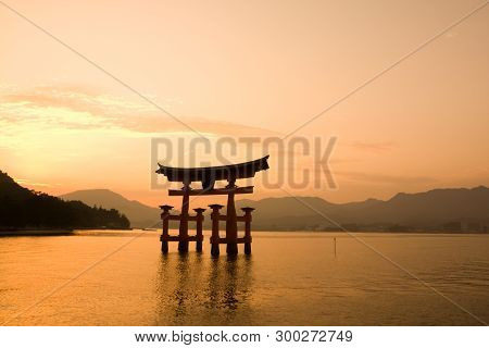 Sunset With Red Torii Gate On The River Of Itsukushima Shrine, Miyajima Island, Japan