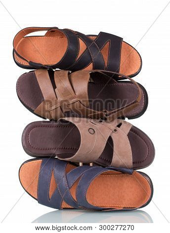 Stack Of Men's Summer Sandals Isolated On White