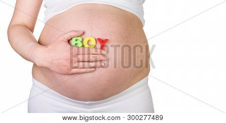 Pregnant Belly Closeup With The Inscription Boy Isolated On White Background