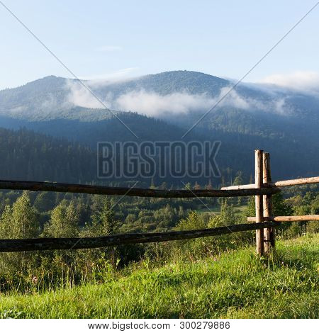 Mountains In Fog, Green Summer Valley. Europe Mountain Village Landscape, Green Valley.