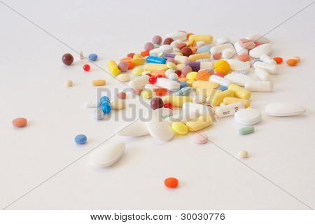 Multi-colored pills on the table