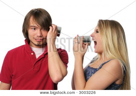 Young Couple Using Tin Can Phone