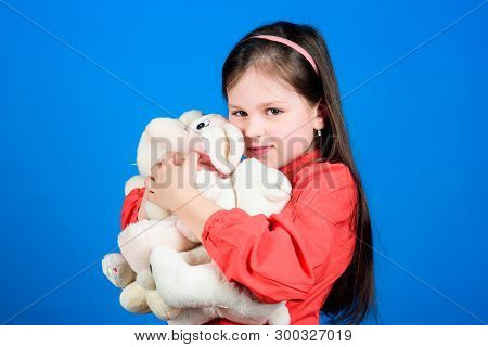 Collecting toys hobby. Cherishing memories of childhood. Small girl smiling face with toys. Happy childhood. Little girl play with soft toy teddy bear. Lot of toys in her hands. Childhood concept poster