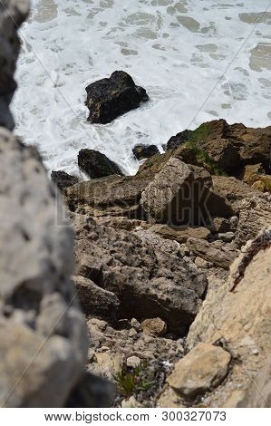 Rocky Cliff On The Beautiful Beach Of Cresmina In Cascais. Photograph Of Street, Nature, Architectur