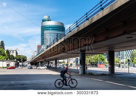 Madrid, Spain - May 1, 2019: Cyclist Running Under Flyover In Paseo De La Castellana Avenue Against