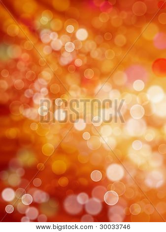 Patches and rays of light of red and yellow colors as holiday background