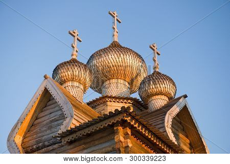 Domes Of The Ancient Wooden Church Of Dmitry The Theunal Myrrh-streaming Close-up Against The Blue S