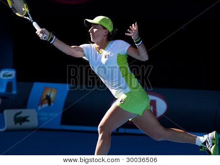 MELBOURNE - JANUARY 27: Svetlana Kuznetsova of Russia in the doubles final at the 2012 Australian Open on January 27, 2012 in Melbourne, Australia.