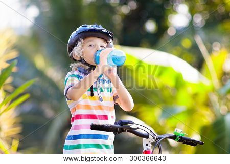 Kids On Bike. Child On Bicycle. Kid Cycling.