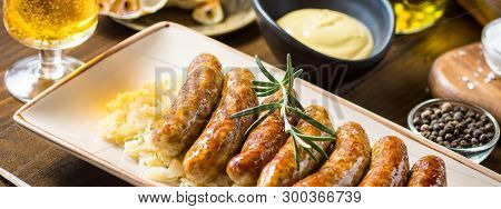 Grilled Sausages With Cabbage Salad, Mustard And Beer. Bratwurst And Sauerkraut.