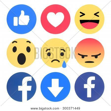 Kiev, Ukraine - April 11, 2019: Facebook 6 Empathetic Emoji Reactions Printed On White Paper. Facebo