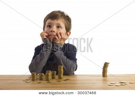 Boy Sitting In Front Of Money-towers