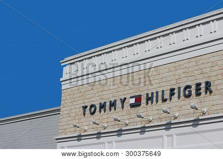 2019 March 26. Tochigi Japan. A Modern Design Of Tommy Hilfiger Brand Name Logo Wall With Blue Sky B