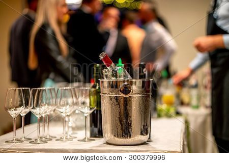 Bucket With Ice, Wine Bottles And Empty Glasses On Table In Restaurant. Ice Bucket, Wine Glasses And