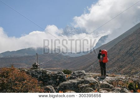 Unidentified Tourist Trekking In Nepal Walking From Dingboche To Chukung Within Sagarmatha National