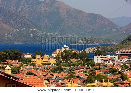 Rooftops, mountains & ocean