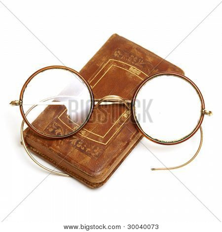 Antique Book And Spectacles