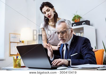 Active Attractive Woman Interrupting Her Busy Senior Boss