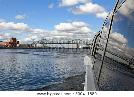View Of Saint Lawrence River With Jacques Cartier Bridge From Cruise Boat. Montreal, Canada.