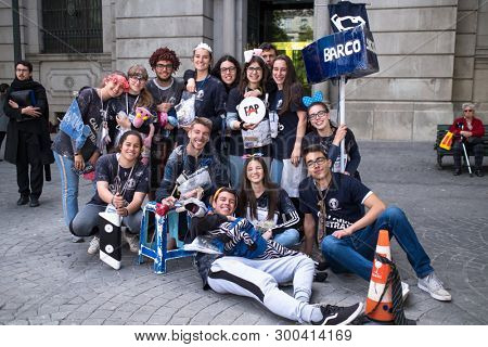 PORTO, PORTUGAL - MAY 6, 2019: During Queima das Fitas is a traditional festivity of Portuguese students of universities. Freshmen wear funny/silly outfits same colour as their Faculty and sing songs.