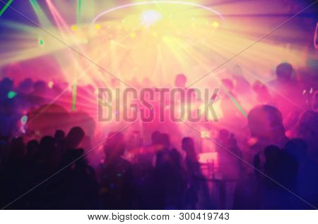 Abstract Blur Light And Silhouette Hands Of Audience Crowd People Enjoying The Club Party With Conce