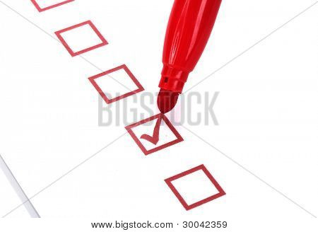 Checklist and red marker closeup