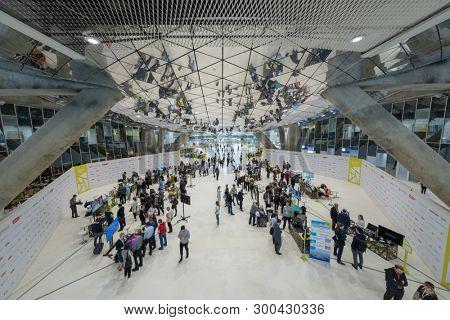 Skolkovo, Russia - April 16, 2019: Visitors watch exhibits of the robotics forum exhibition