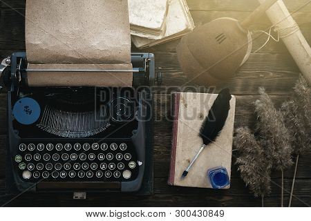 Typewriter And Book On A Writer Author Table Background. Memoirs.