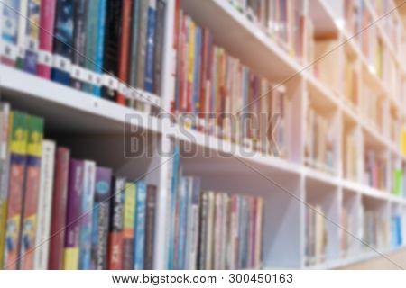 Books In Public Library With Bookshelves. Stack Piles Of Literature Text For Reading Books In Univer