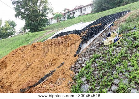 Slope Erosion Control Materials With Grids, Sheets And Earth On Steep Slope To Manage Landslide