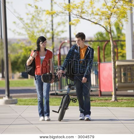 Teens Couple Walks Through Park