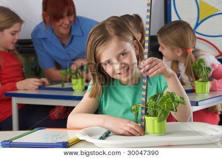 Girl learning about plants in school class