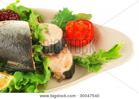 served salmon with caviar on plate over white