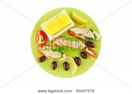 sandwich with salmon chunks,salad, and olives