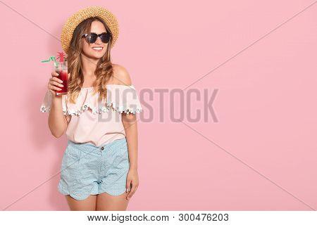 Bautiful Girl In Sunglasses, Straw Hat, Summer Blouse And Short Drinking Summer Cocktail, Looking Sm